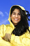 Beautiful young woman in raincoat Stock Image