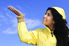 Beautiful young woman in raincoat royalty free stock photos