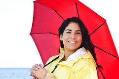 Beautiful young woman in raincoat with umbrella Stock Image