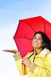 Beautiful young woman in raincoat with umbrella Royalty Free Stock Image