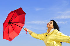 Beautiful young woman in raincoat with umbrella Royalty Free Stock Images