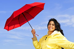 Beautiful young woman in raincoat with umbrella Stock Photography