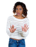 A beautiful young woman raising hands up to say stop it. Closeup portrait of beautiful shocked mad young woman raising hands up to say no stop right there Royalty Free Stock Photos