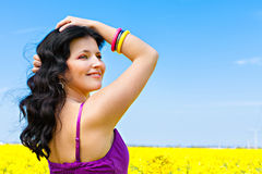 Beautiful young woman on rape field Royalty Free Stock Images