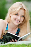 Beautiful young woman read book Stock Images