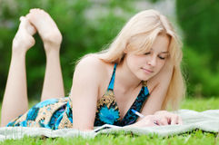 Beautiful young woman read book Royalty Free Stock Photo