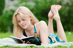 Beautiful young woman read book Royalty Free Stock Image