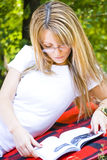 Beautiful young woman reading book Royalty Free Stock Photo