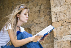 Beautiful young woman reading book Stock Image