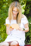 Beautiful young woman reading book Royalty Free Stock Images