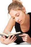 Beautiful young woman reading book Royalty Free Stock Image