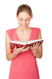 Beautiful young woman reading book Stock Photography