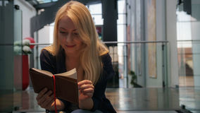 Beautiful young Woman. Reading a book Royalty Free Stock Images