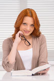 Beautiful young woman reading book. stock photos