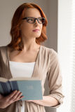 Beautiful young woman reading book. Stock Images