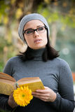 Beautiful young woman reading a book Stock Image
