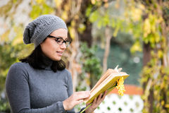 Beautiful young woman reading a book Stock Images
