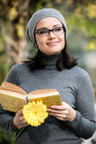 Beautiful young woman reading a book Royalty Free Stock Photography
