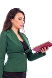 Beautiful young woman reading a book Royalty Free Stock Photo