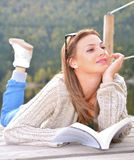 Beautiful young woman reading a book Stock Photos
