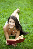 Beautiful young woman reading a book outdoor Stock Photos