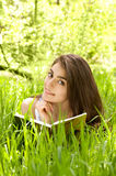 Beautiful young woman reading book Stock Images