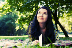 Beautiful young woman reading outdoor Royalty Free Stock Photography