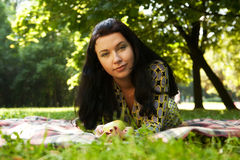 Beautiful young woman reading outdoor Stock Photos