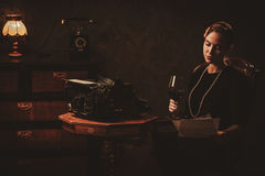 Beautiful young woman reading in retro interior Royalty Free Stock Photography