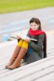 Beautiful young woman reads book Stock Photos