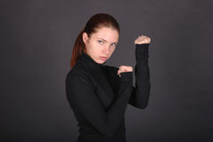 Beautiful young woman ready to fight Stock Photos
