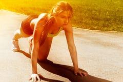 Beautiful young woman ready to run. Beautiful young woman getting ready to run from lying pose stock photo