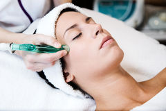 Beautiful young woman receiving cupping treatment in spa. Royalty Free Stock Photos