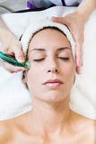 Beautiful young woman receiving cupping treatment in spa. Stock Images
