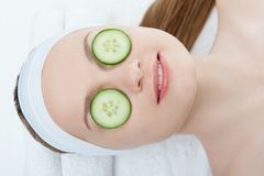 Beautiful young woman receiving facial mask of Stock Image