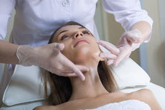 Beautiful young woman receiving facial massage Stock Photo