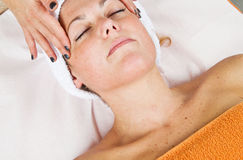 Beautiful young woman receiving facial massage Stock Photos