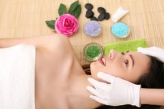 Beautiful young woman receiving facial massage in spa salon.  stock image