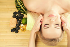Beautiful young woman receiving facial massage at a spa salon. A beautiful young woman receiving facial massage at a spa salon. Perfect Skin. Skincare. Young stock images