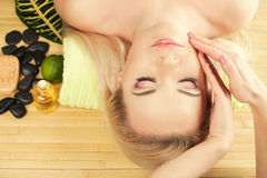 A beautiful young woman receiving facial massage at a spa salon. Perfect Skin. Skincare. Young Skin. Copy-space. Close up royalty free stock photo