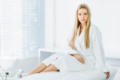 Beautiful young woman receiving facial massage royalty free stock photo