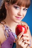 Beautiful young woman with red apple Stock Images