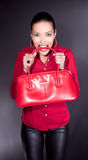 Beautiful young woman with red bag in teeth Stock Image