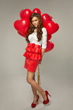 Beautiful young woman with red balloon heart shape for valentine Stock Image