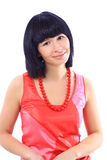 Beautiful young woman with red beads Stock Images