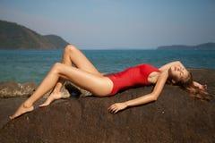 Beautiful woman in red bikini lying and sunbathing Royalty Free Stock Photography