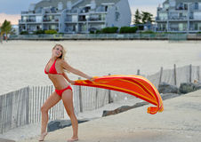 Beautiful young woman in red bikini - with towel Stock Image