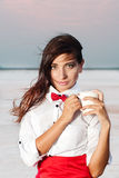 Beautiful young woman with red bow tie Stock Image