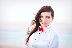 Beautiful young woman with red bow tie Royalty Free Stock Photos