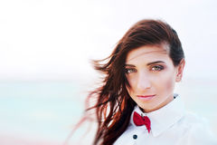 Beautiful young woman with red bow tie Royalty Free Stock Photography